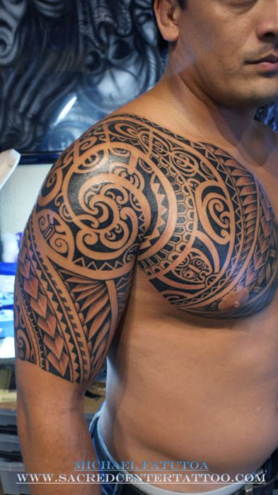 Swirly Polynesian chest and half sleeve tattoo