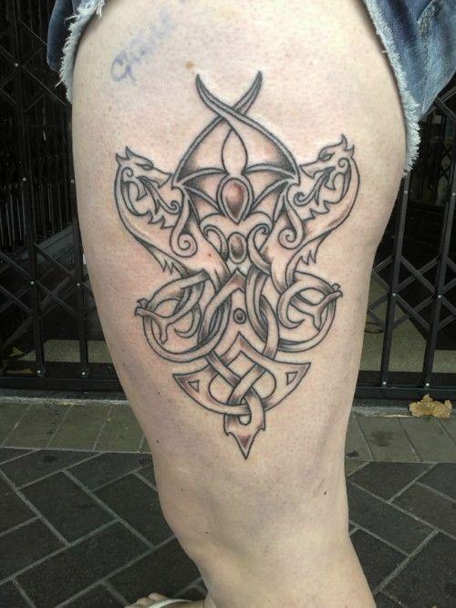 Tribal Celtic dragon tattoo on leg